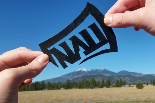 NAU logo held over peaks