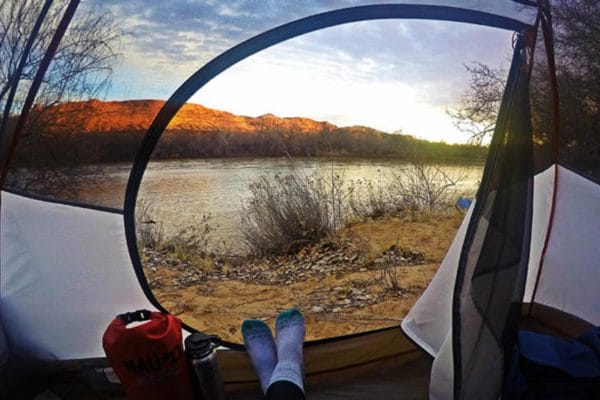 view from inside camping tent looking outside to wilderness