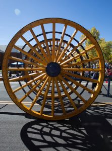 The NAU logging wheels roll in every homecoming parade.