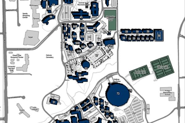An overhead map of N A U from south Milton road in the west to Lone Tree road in the east and west University drive in the north to east Pine Knoll drive in the south. Buildings are blue with the building number, parking lots are light gray, and fields are gray green. The overall map is white.