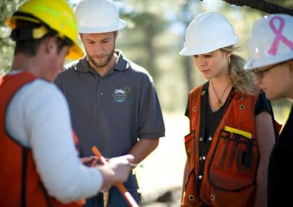 nau students discuss an environmental project