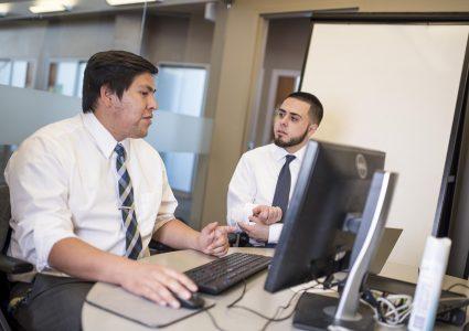 2400-nau-business-students-work-together-at-computer.jpg