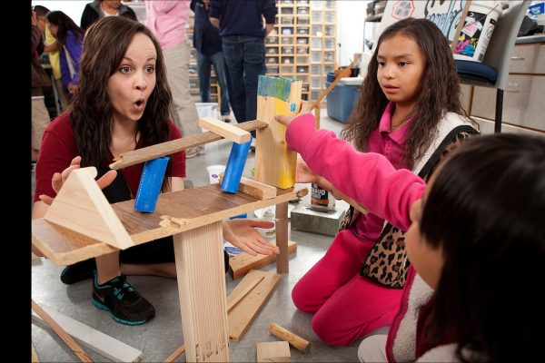 NAU student plays with children