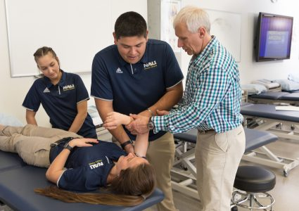 athletic training professor demonstrates technique