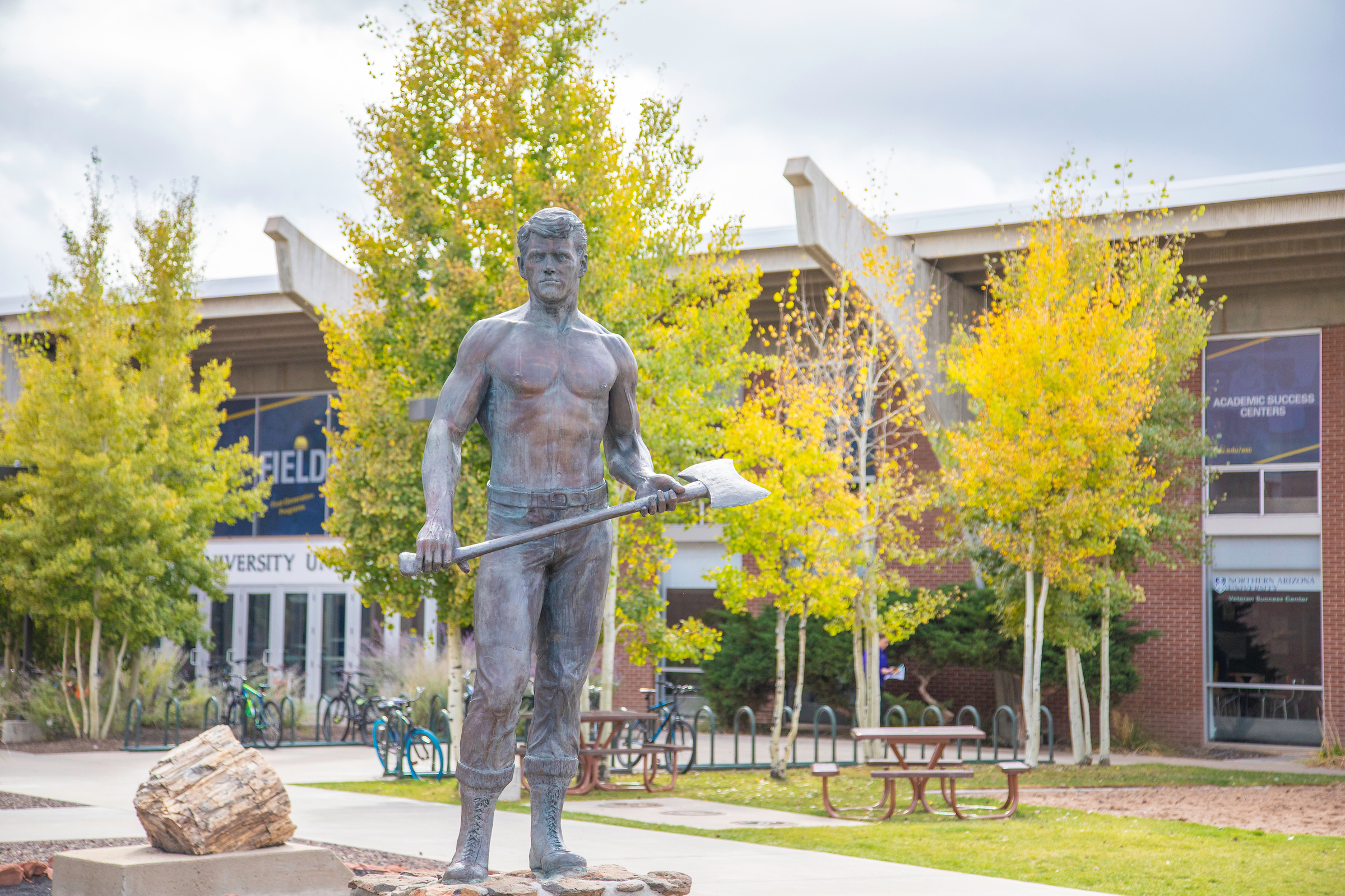 a statue of a lumberjack on the Flagstaff campus