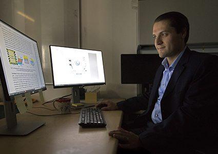 Abolfazl Razi sitting in his office in the SICCS building.