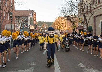 nau homecoming pep rally with cheerleaders and Louie