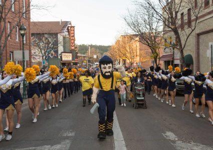 nau homecoming pep rally with cheerleaders and Louie