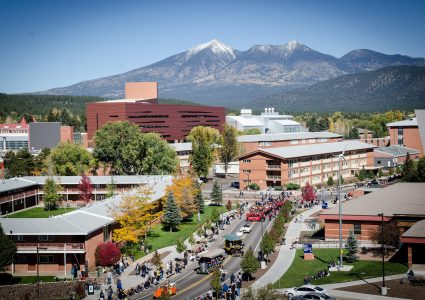 NAU Homecoming parade on campus with the mountain in the background.