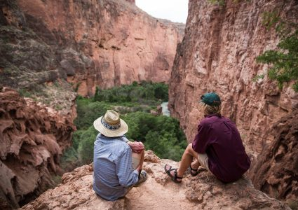 students overlook a stunning red canyon