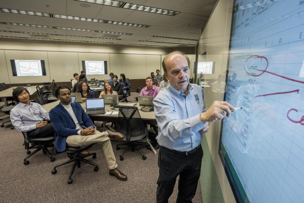 nau professor teaches economics to business class at nau in flagstaff