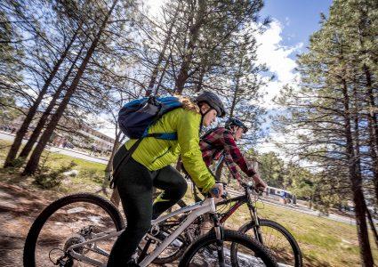 nau-students-riding-bikes-on-trail