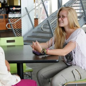 2 NAU STAR students talking in the union