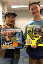 students holding vision board