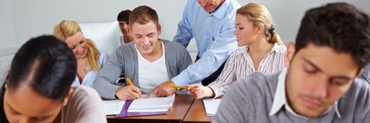 Teacher providing instruction to student.