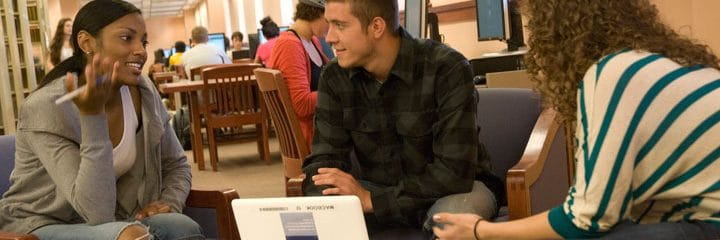 College students in conversation at Library
