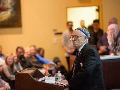 jacob eisenbach speaks during martin-springer institute programming