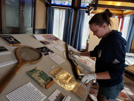 An NAU history student is looking at artifacts