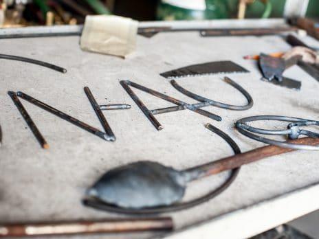metal scrap spelling out NAU