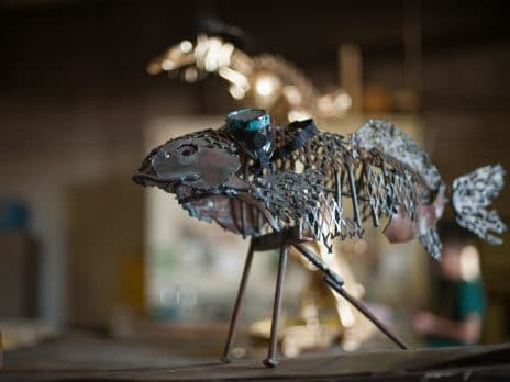 a fish sculpture made of reclaimed metal