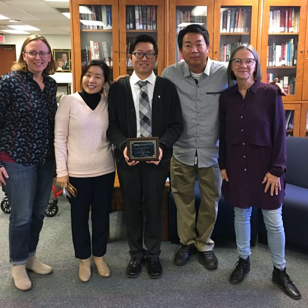 School of Art Outstanding Senior Randy Chung poses with his parents and faculty advisors.
