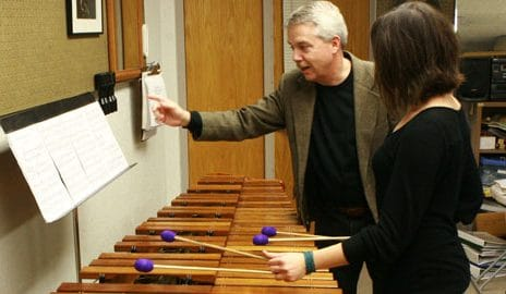 instructor leading student through xylophone audition