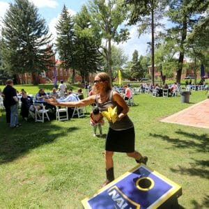 NAU Faculty and Staff playing corn hole at the Alumni BBQ