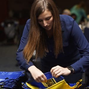 NAU graduate preparing her gown for graduation