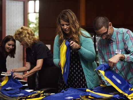 Alumni volunteers partake in the Alumni Association Board Backpack Stuffing