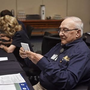 NAU Alumnus reviewing photos