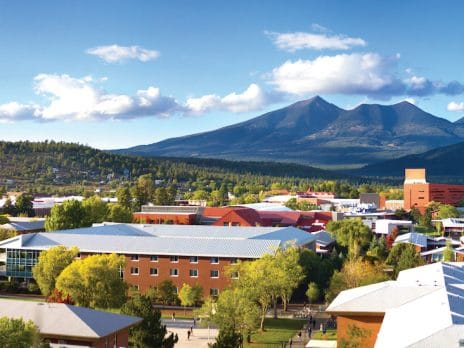 nau campus in flagstaff shows buildings and mountains in the background