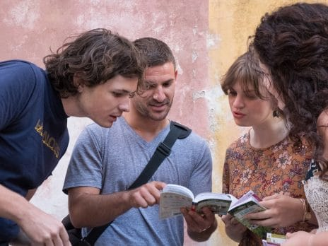 students abroad examine a dictionary