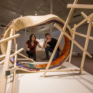 Two students explore an installation in the NAU Art Museum