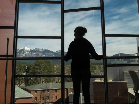 student staring out of window
