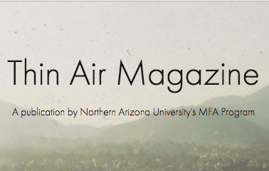 "words ""thin air magazine"" with foggy mountains in background"