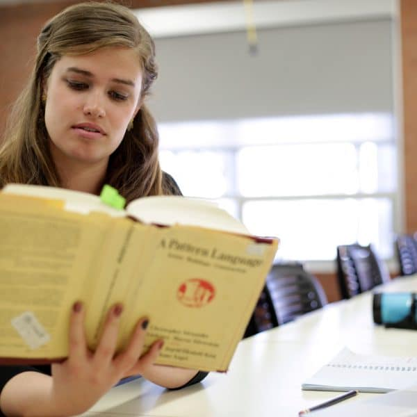 a student reads in a classroom