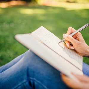 Image of person writing in journal