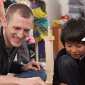 Teacher working with young student