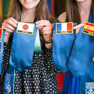 NAU students with patches of the places they studied abroad.
