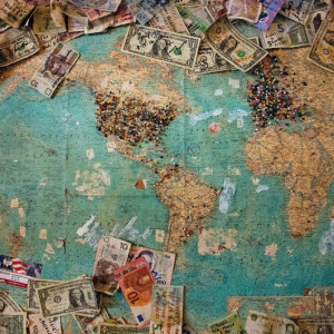 map with many pins and money from different countries