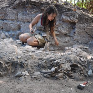 student at archaeological site