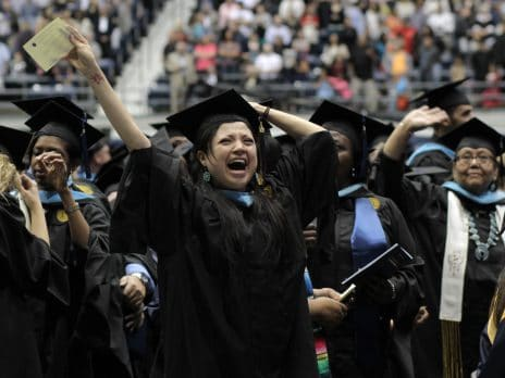 female nau graduate college student shows excitement at close of graduation ceremonies in Flagstaff