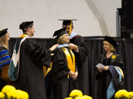 Doctoral Student being hooded at Commencement