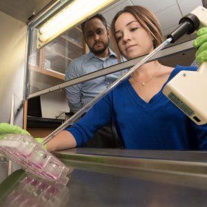 Student in Lab with Scientific Equipment
