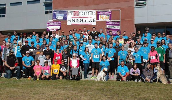 All the participants gather at the finish line for a group photo.