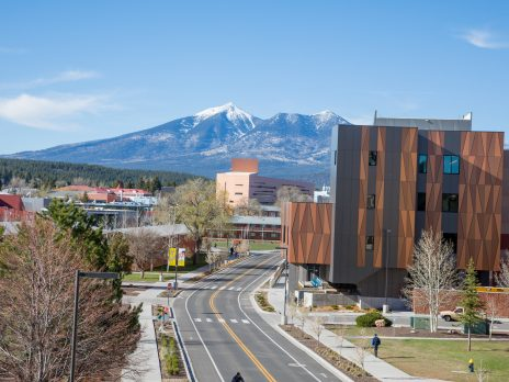 NAU campus in Flagstaff looking north with snow capped San Francisco mountains in the distance
