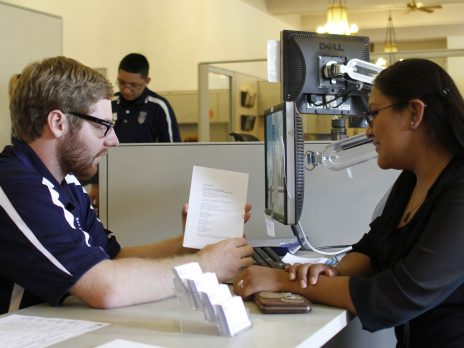 nau financial aid advisor discusses grants with student