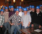 A group of Construction Management students in a group wearing hard hats