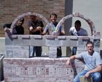 NAU Construction Management students posing with their model creation
