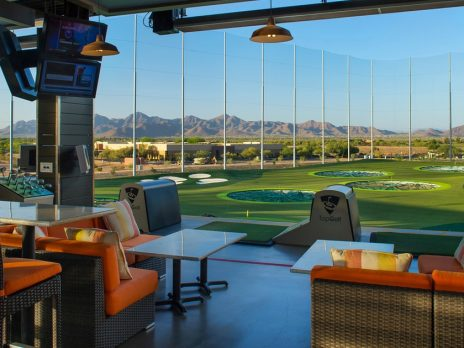 TopGolf lounge and golf area overlooking the mountains in the distance